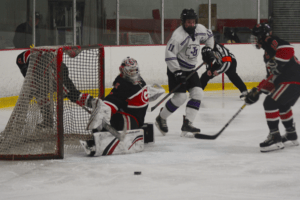 Anabelle Thomas makes a save against John Jay on March 1. Thomas made 26 saves in the Garnets' 5-1 championship win.