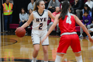 Natasha Meyer looks for an open teammate against Somers on Feb. 26. Meyer scored 16 points, including the game-winner.