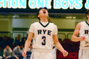 Rafael Velazquez celebrates the final moments of Rye's historic victory on March 8. Photos/Mike Smith